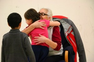 Community Elder Flora McCallum hugs the Grade 1-2 students after her presentation for Aboriginal Storytelling Day.